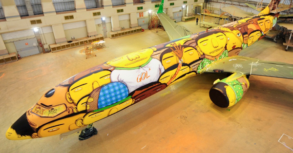 In collaboration with with the Brazilian national football team, and GOL Airlines, OSGEMEOS painted the Boeing used for the World Cup.