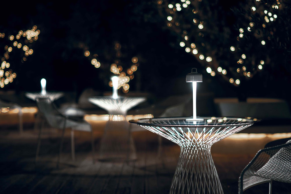Furnishing and lighting an outdoor hospitality space